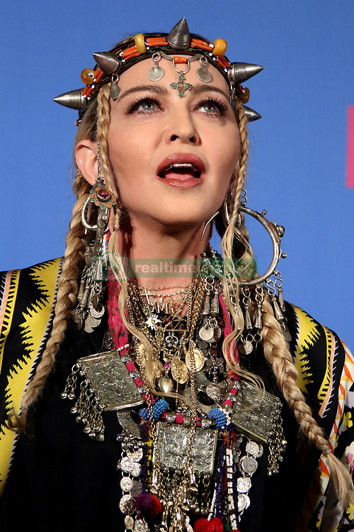 August 20, 2018 - New York City, New York, U.S. - Singer MADONNA poses for photos in the press room for the 2018 MTV 'VMAS' held at Radio City Music Hall. (Credit Image: © Nancy Kaszerman via ZUMA Wire)