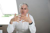 21 MAY 2012, BERLIN/GERMANY:<br /> Christophe F. Maire, Gruender / CEO txtr, Inhaber atlantic ventures, Investor und  Business Angel, waehrend einem Interview, txtr GmbH, Rosenthaler Str., Berlin-Mitte<br /> IMAGE: 20120521-02-011<br /> KEYWORDS: Christophe Maire