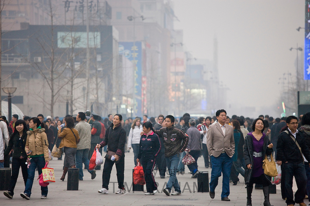 Crowded Wangfujing street and shops in Central Beijing, China