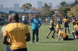 JOHANNESBURG, SOUTH AFRICA MAY 28: Center, coach Rassie Erasmus with Springbok rugby players during training on 28 May 2018 in Johannesburg South Africa. Both Pieter-Steph du Toit and Siya Kolisi were announced by Springboks coach Rassie Erasmus as captains ahead of upcoming international games against Wales and England, the Springbok captaincy is a first for both players. They attended a training session with the Springbok rugby squad and coaching staff at St Stithians School. (Photo by Dino Lloyd)