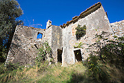 Derelict house ruins in ancient village of Old Perithia - Palea Peritheia, Northern Corfu, Greece