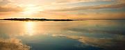 A beautiful sun rising over water.