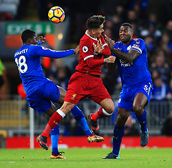 Roberto Firmino of Liverpool challenges for a header with Daniel Amartey and Wes Morgan of Leicester City - Mandatory by-line: Matt McNulty/JMP - 30/12/2017 - FOOTBALL - Anfield - Liverpool, England - Liverpool v Leicester City - Premier League