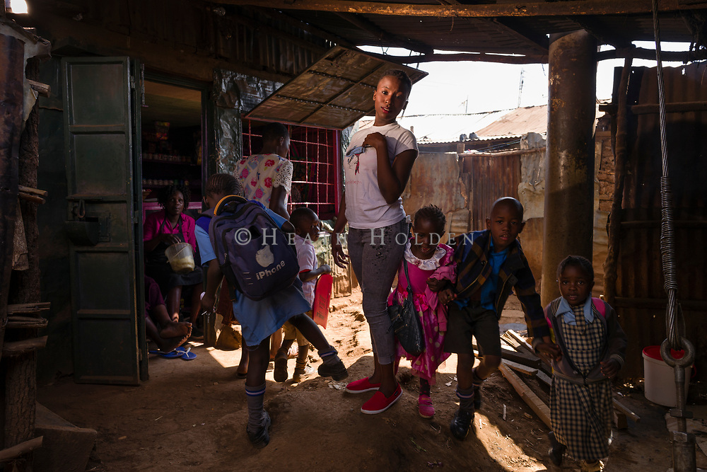 A fan of fashion, Felicitia Auma navigates through the busy laneways of Kibera in Nairobi Kenya on Wednesday 18th of September.