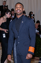 Michael B. Jordan walking the red carpet at The Metropolitan Museum of Art Costume Institute Benefit celebrating the opening of Heavenly Bodies : Fashion and the Catholic Imagination held at The Metropolitan Museum of Art  in New York, NY, on May 7, 2018. (Photo by Anthony Behar/Sipa USA)
