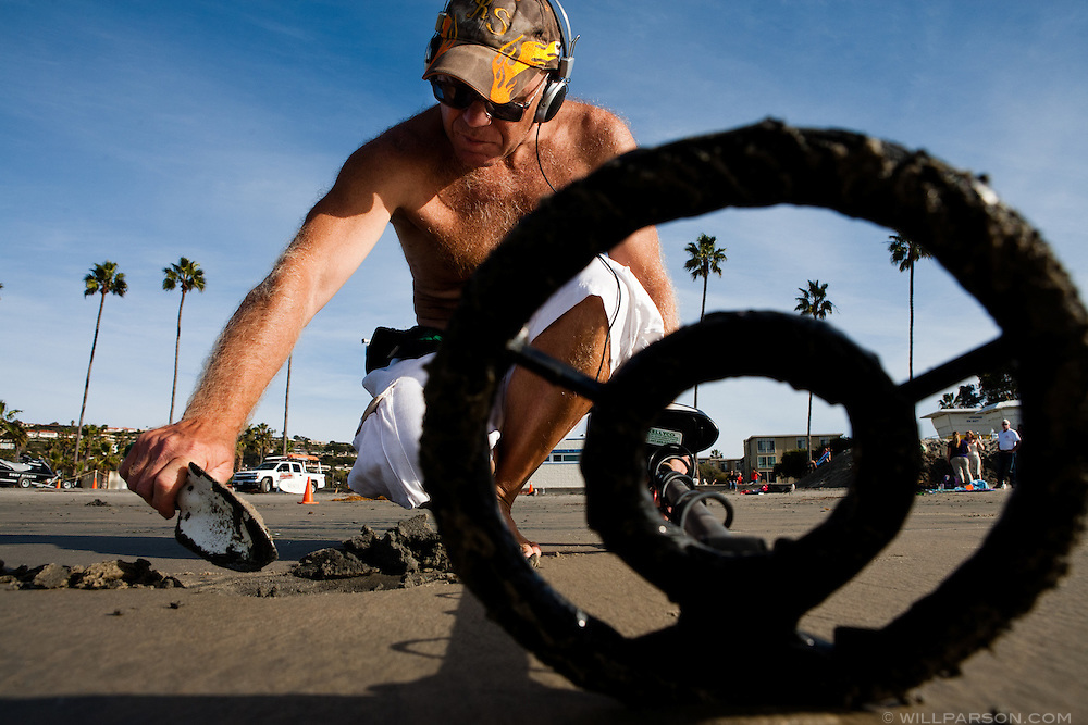 Victor Filippov, visiting from Russia, uses a metal detector at La Jolla Shores Beach on December 19. The previous day he had found a platinum ring worth $320. San Diego tied a record high temperature of 80 degrees on the same day a freezing storm hit much of the East Coast.