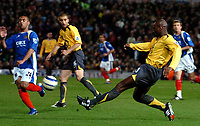 Photo: Ed Godden.<br />Portsmouth v Arsenal. The Barclays Premiership. 12/04/2006. Arsenal's Sol Campbell passes the ball.