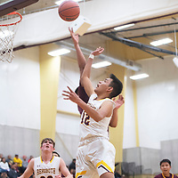 Rehoboth Lynx Seth Lee (12) drives to the basket for a layup against the Tohatchi Cougars Tuesday night in Rehoboth. Rehoboth defeated Tohatchi 64-40.