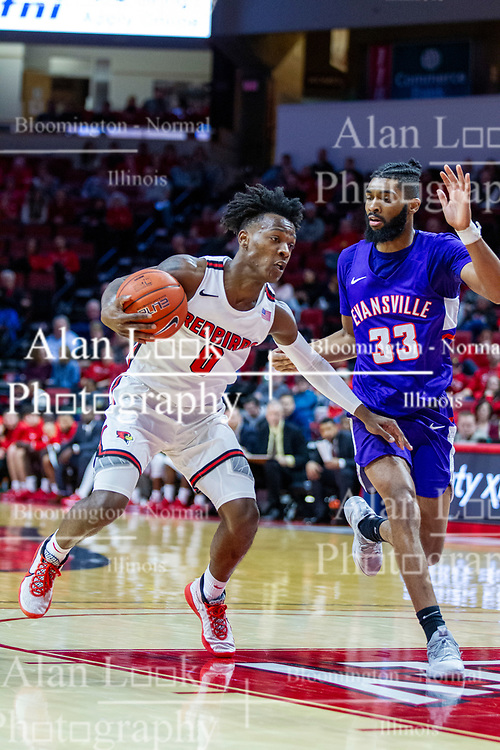 NORMAL, IL - January 29: DJ Horne takes the lane defended by K.J. Riley during a college basketball game between the ISU Redbirds and the University of Evansville Purple Aces on January 29 2020 at Redbird Arena in Normal, IL. (Photo by Alan Look)