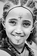 Lalibela, Ethiopia - August 23, 2010: A 7-year-old girl attends a festival in Lalibela. The city is a center of Ethiopian Orthodoxy, best known for its centuries-old stone churches.