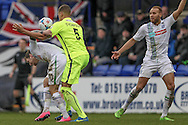 Josh Thompson (Southport) fouls James Norwood (Tranmere Rovers) and gives a free kick on the edge of the box during the Vanarama National League match between Tranmere Rovers and Southport at Prenton Park, Birkenhead, England on 6 February 2016. Photo by Mark P Doherty.
