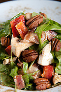 Green Salad with lettuce, tomatoes, mushroom and pecan nuts
