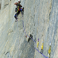 BAFFIN ISLAND, Nunavut, Canada. Alex Lowe (MR) leads a very difficult aid pitch, high on Great Sail Peak, an Arctic big-wall rock climb. If he falls, all anchors (except his belay) could pull out.