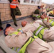 Resting Blues ground staff engineers await return of the Red Arrows, Britain's RAF aerobatic team.