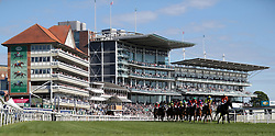 Runners and Riders round the first bend during The Investec Wealth Stakes during day two of the Dante Festival at York Racecourse.