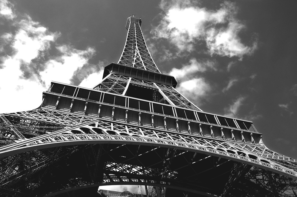 Looking upward from the base of the Eiffel Tower in Paris. Photo by Adel B. Korkor.