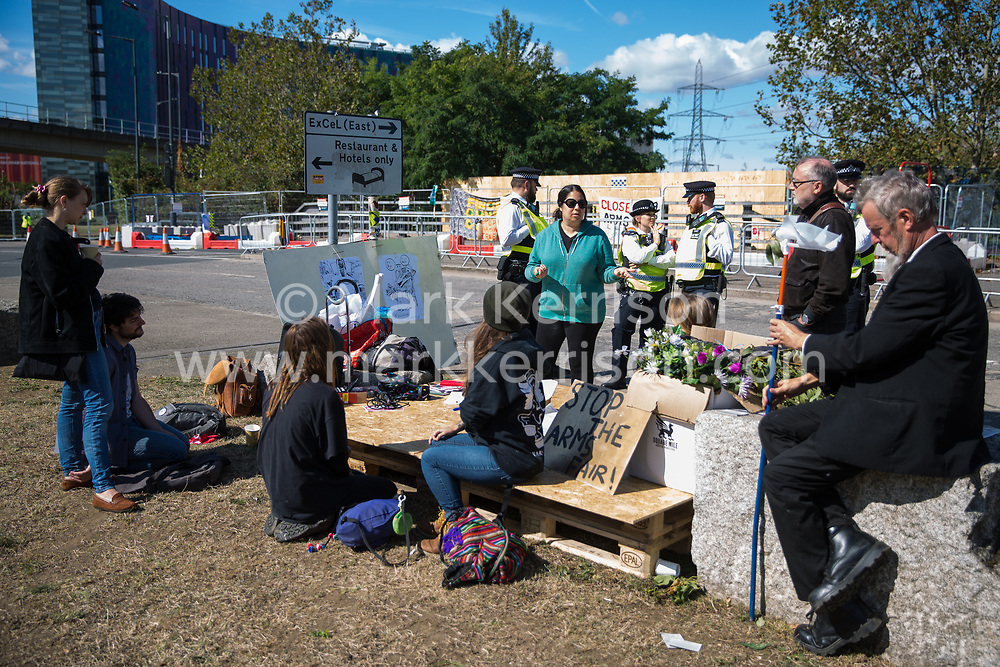 London, UK. 5 September, 2019. Activists take part in a Conference At The Gates (CATG) outside ExCel London on the fourth day of a week-long carnival of resistance against DSEI, the world's largest arms fair. The CATG involved a series of workshops themed around the arms trade in the context of state violence, with a particular focus on the issue of race.