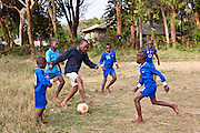 Boys playing football in the grounds of the AFCIC residential centre in Thika, Kenya. AFCIC - Action for children in conflict, help children who have been affected by various forms conflict or crisis.