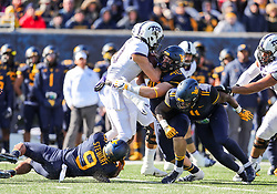 Nov 10, 2018; Morgantown, WV, USA; West Virginia Mountaineers defensive lineman Reese Donahue (46) tackles TCU Horned Frogs quarterback Michael Collins (10) during the first quarter at Mountaineer Field at Milan Puskar Stadium. Mandatory Credit: Ben Queen-USA TODAY Sports