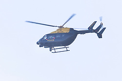 © Licensed to London News Pictures. 20/12/2018. London, UK. A police helicopter fly low over the runway at Gatwick airport as the hunt for a drone operator continues. Flights have been cancelled and thousands of passengers have been delayed after the airport closed due to two drones being spotted nearby. Photo credit: Peter Macdiarmid/LNP