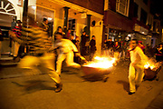 Lewes, UK. Monday 5th November 2012. Cliffe bonfire society members burning barrel race. Bonfire Night celebration in the town of Lewes, East Sussex, UK which form the largest and most famous Guy Fawkes Night festivities. Held on 5 November, the event not only marks the date of the uncovering of the Gunpowder Treason and Plot in 1605, but also commemorates the memory of the 17 Protestant martyrs from the town burnt at the stake for their faith during the Marian Persecutions of 1555–57. There are six bonfire societies putting on parades involving some 3,000 people.