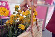 person holding carefully a bag with flowers