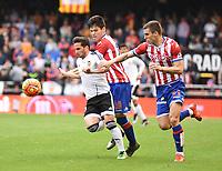 Valencia CF's  Pablo Piatti  and Sporting de Gijon's  Jorge Mere and Vranjes during La Liga match. January 31, 2016. (ALTERPHOTOS/Javier Comos)