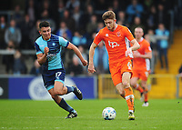Blackpool's Will Aimson under pressure from Wycombe Wanderers' Luke O'Nien<br /> <br /> Photographer Kevin Barnes/CameraSport<br /> <br /> The EFL Sky Bet League Two - Wycombe Wanderers v Blackpool - Saturday 11th March 2017 - Adams Park - Wycombe<br /> <br /> World Copyright © 2017 CameraSport. All rights reserved. 43 Linden Ave. Countesthorpe. Leicester. England. LE8 5PG - Tel: +44 (0) 116 277 4147 - admin@camerasport.com - www.camerasport.com