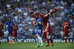 Liverpool's Virgil van Dijk climbs all over Chelsea's Olivier Giroud