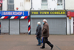 © Licensed to London News Pictures 16/02/2021.        Dartford, UK. Shutters down on non-essential shops. People out and about in Dartford town centre in Kent today during a third national coronavirus lockdown. Non-essential shops could open in weeks if the Covid-19 infection rate keeps dropping. Photo credit:Grant Falvey/LNP