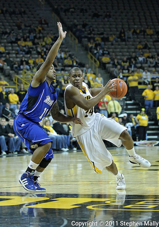 December 17, 2011: Iowa Hawkeyes guard Bryce Cartwright (24) drives around Drake Bulldogs guard Karl Madison (11) during the the NCAA basketball game between the Drake Bulldogs and the Iowa Hawkeyes at Carver-Hawkeye Arena in Iowa City, Iowa on Saturday, December 17, 2011. Iowa defeated Drake 82-68.