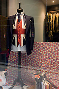 A patriotic Union jack wastecoat on display in a City of London taylor's shop on St George's Day. The theme of the day is that of England's national celebration of national identity, when city workers wear the colour red and the British union jack flag.