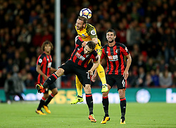 Brighton & Hove Albion's Glenn Murray (top) and AFC Bournemouth's Marc Pugh (bottom) battle for the ball