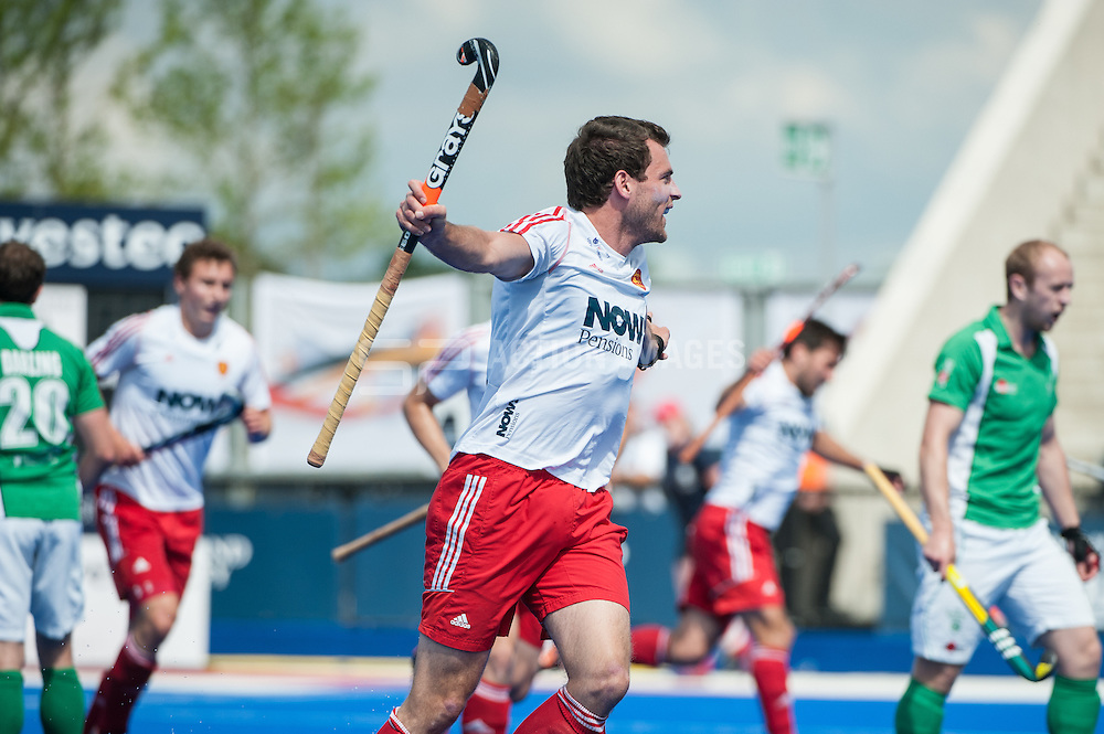 England's Alastair Brogdon celebrates scoring their first goal in the final of the Investec London Cup, Lee Valley Hockey & Tennis Centre, London, UK on 13 July 2014. Photo: Simon Parker