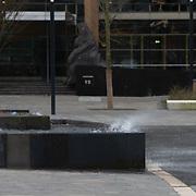 NLD/Utrecht/20200209 - Harde wind blaast het water uit een waterbassin op het Jaarbeursplein in Utrecht door de storm Ciara die over Nederland raast