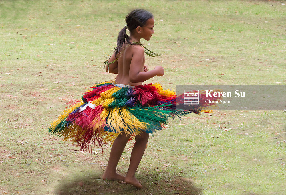 Little Yapese girl in traditional clothing twirling at Yap Day Festival, Yap Island, Federated States of Micronesia