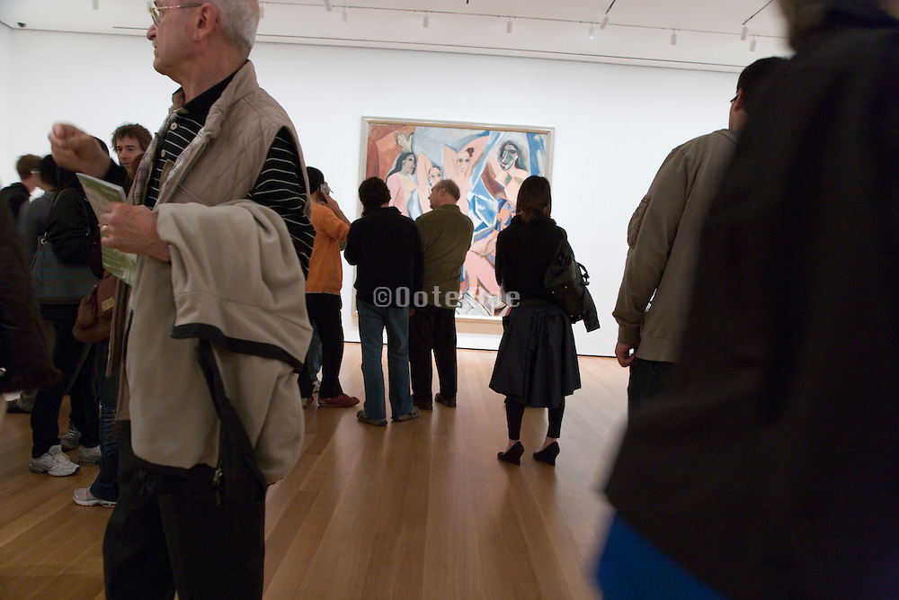 crowd in the Museum of Modern Art in NYC in front of Picasso Les Desmoiselles D?ÄôAvignon
