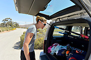 """San Diego, California. USA.  USA. Double Olympian Gold Medalist,  Zsuzsanna """"Susan"""" FRANCIA, load's her Jeep with sculls.  Boathouse, Lower Otay Reservoir,  rowing training course, Olympic Committee's ARCO Training Center in Chula Vista California.   {TIME{  {DOW}  11/04/2013  [Mandatory Credit. Peter Spurrier/Intersport Images] .."""
