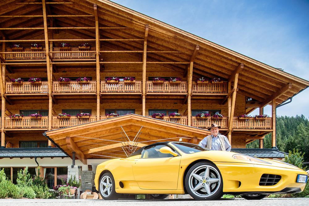 """04 JUL 2014 - Moso, Sesto (BZ) - Location della fiction """"Un passo dal cielo"""" - Hotel """"Bad Moos"""". Il titolare Erwin Lanzinger con la sua Ferrari"""