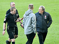 Football - 2020 / 2021 Sky Bet Championship - Swansea City vs Middlesbrough - Liberty Stadium<br /> <br /> Middlesbrough manager Dave Warnock speaks to referee Mr Gavin Ward on the pitch  as the officials head for the dressing room at half time<br /> <br /> <br /> COLORSPORT/WINSTON BYNORTH