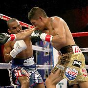 Richard Rodriguez (R) lands a shot the head of Jonathan Gonzalez during a Telemundo boxing match between at Osceola Heritage Park on Friday, February 23, 2018 in Kissimmee, Florida.  (Alex Menendez via AP)