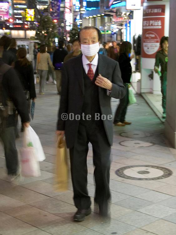 elderly man walking in a shopping street Tokyo
