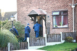 © Licensed to London News Pictures. 25/11/2020. Manchester, UK. Police search a house at the scene after closong a stretch of Hollins Lane in Middleton. A van from the Royal Logistical Corps, firefighters and a large police presence have been seen and it's understood a man has been arrested by anti terror police . Photo credit: Joel Goodman/LNP