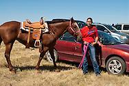 Fort Belknap Indian Reservation, Montana, Milk River Memorial Horse Races, woman rider.