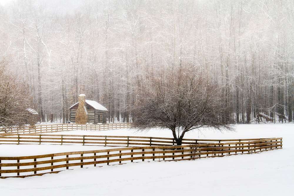 """A quaint log cabin and long fence are a nice compliment to the beautiful trees, heavy with snow.<br /> <br /> Available sizes:<br /> 12"""" x 8"""" print<br /> <br /> See Pricing page for details. <br /> <br /> Please contact me for custom sizes and print options including canvas wraps, metal prints, assorted paper options, etc. <br /> <br /> I enjoy working with buyers to help them with all their home and commercial wall art needs."""