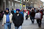 Scenes at Brick Lane, East London. Two Sikh men.