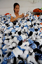 July 19, 2017 - Lianyungang, Lianyungang, China - Lianyungang, CHINA-July 17 2017: (EDITORIAL USE ONLY. CHINA OUT) ..A woman works at a toy factory in Lianyungang, east China's Jiangsu Province, July 17th, 2017. The Snoopy toys are exported to many countries and regions in Europe and America. (Credit Image: © SIPA Asia via ZUMA Wire)
