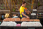 Egg vendor at the Luang Prabang, Laos, morning food market.