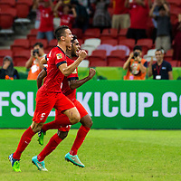 Baihakki Khaizan (#5) and Hariss Harun (#14) of Singapore celebrate a goal against Myanmar during the group stage match of the AFF Suzuki Cup at the National Stadium at the Singapore Sports Hub on November 26, 2014, in Singapore.