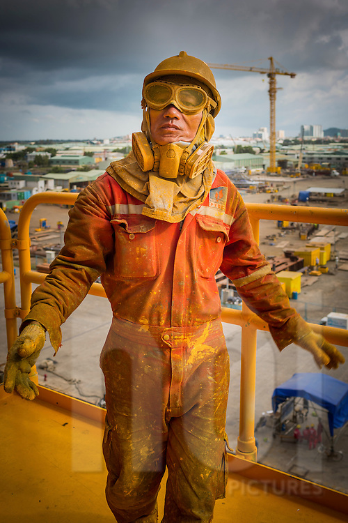 Worker in an industrial harbor of Vung Tau, Vietnam, Southeast Asia